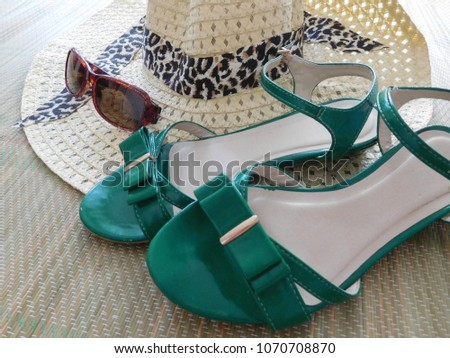 fashion background, woman's accessories - green sandals, brown sunglasses, straw hat - summer