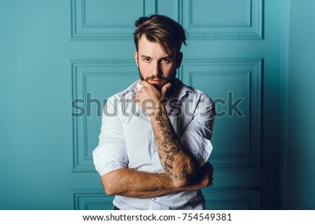 fashion beard man portrait, tattoo hand, Handsome man beard using smartphone in hand, happy face, street photo, hipster style portrait, tattoo