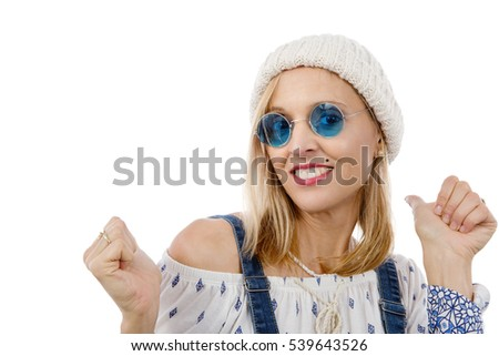 fashion beautiful blonde woman with blue sunglasses and winter hat - Shutterstock ID 539643526