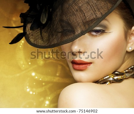 Fashion Beautiful Woman over luxury gold background