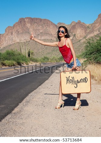 Fashion beauty editorial shoot.  Beautiful girl hitch hiking to Hollywood.