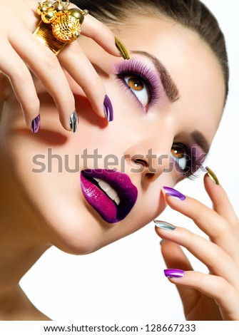 Fashion Beauty . Manicure and Make-up. Nail Art. Beautiful Woman With Colorful Nails and Luxury Makeup. Beautiful Girl Face and Hand