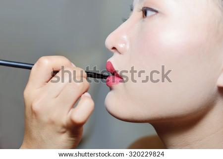 Fashion Beauty Model Girl Make - up.Sexy red lip Close-up