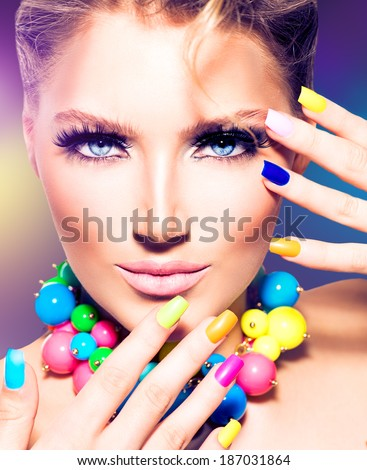 Fashion Beauty model girl with colorful Nails. Vivid rainbow manicure and accessories. Beautiful woman portrait with perfect makeup