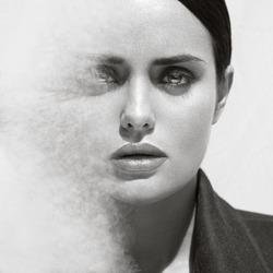 Fashion beauty portrait of beautiful brunette model with smoke dispersion. Professional makeup. Smoky eyes.