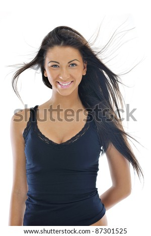 fashion beauty shoot with happy young girl isolated on white with wind in hair  in studio