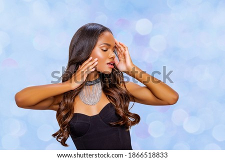 Fashion black model girl  in trendy silver jewelry in studio. isolated. Beautiful African American girl with necklace jewelry. Beauty and accessories.