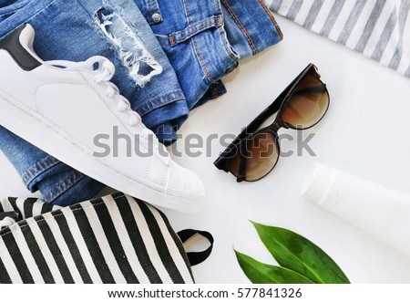 Shutterstock fashion blogger concept. Minimal set of Feminine accessories on white background.