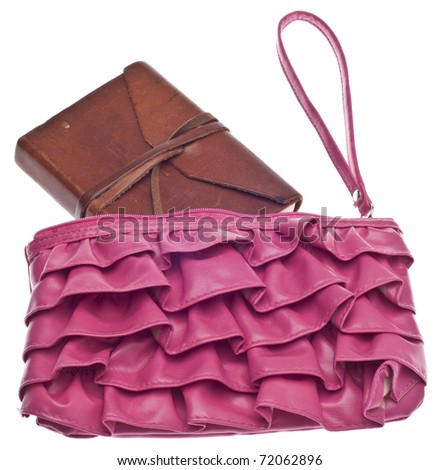 Fashion Blogging Concept with Clutch Purse and Brown Journal on White. - stock photo