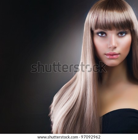 Fashion Blond Girl. Beautiful Makeup and Healthy Hair over Black Background