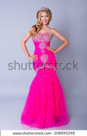 Fashion blond princess woman with pink makeup and dress. Barbie