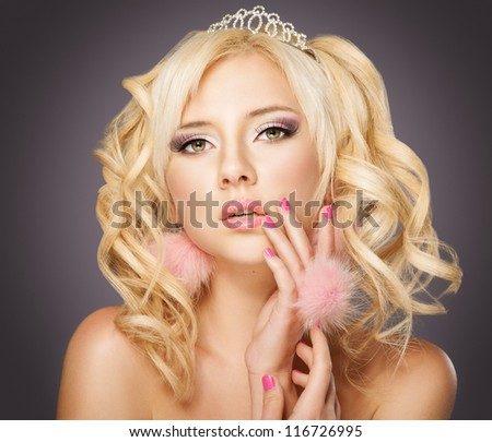 Fashion blond princess woman with pink makeup and manicure, curly hair