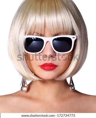 Fashion Blonde Model with Sunglasses. Glamorous young woman with short bob hairstyle isolated on white. Vogue Style Girl. Haircut