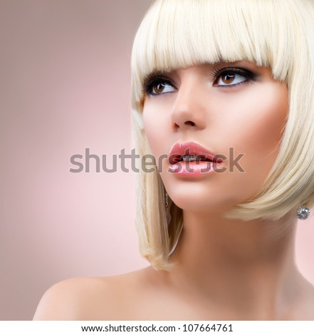 Fashion Blonde Woman Portrait. Blond Hair. Hairstyle. Haircut. Makeup
