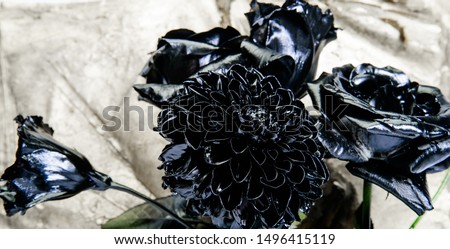 Fashion bouquet. Botany concept. Forging and sculpture. Beautiful black silver flower. Floral shop. Metallic steel color. Flower covered metallic paint. Metal flower. Abstract art. Eternal beauty.