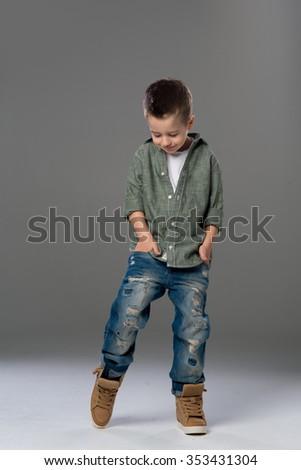 Fashion boy looking down on grey background  #353431304