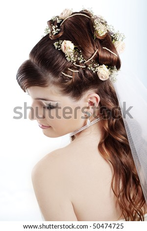 Fashion bridal hairstyle with floral decoration