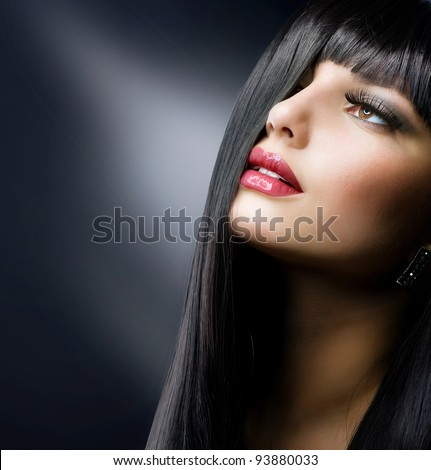 Fashion Brunette . Beautiful Makeup and Healthy Black Hair