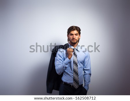 Fashion business man, Handsome male model blue shirt and tie suit, young businessman over gray background