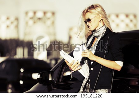 Fashion business woman with financial papers at the car  #195181220