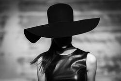 Fashion catwalk runway event, model walking the show finale.
