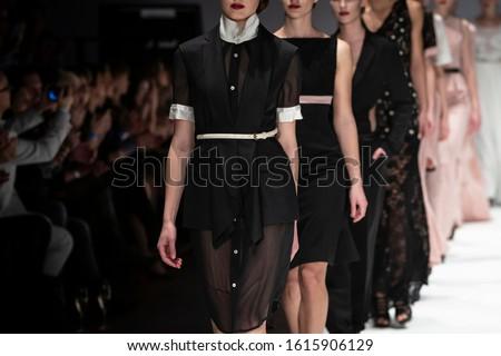 Fashion catwalk runway event, model walking the show finale. Fashion week themed photograph. Сток-фото ©