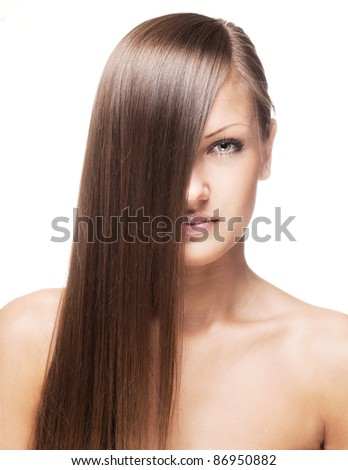fashion closeup portrait of a young woman with beautiful long hair