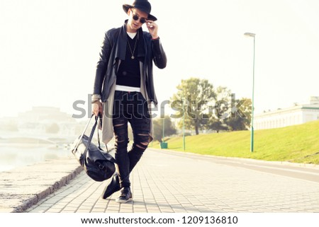 Fashion, clothes and people concept - stylish handsome man in trendy outfit with sunglasses #1209136810