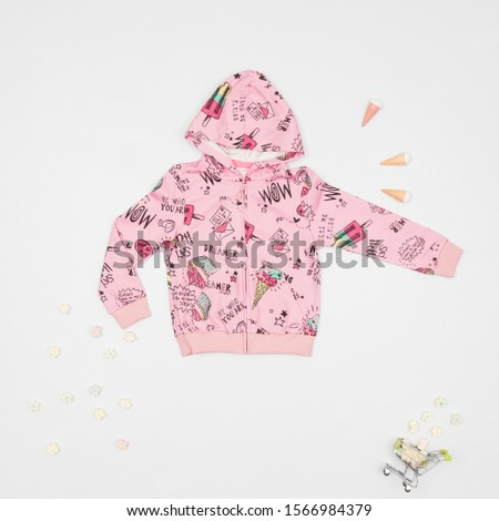 Fashion clothes; clothes for little girl photo on neutral background.