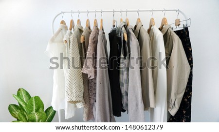 Fashion clothes hanging on clothing rack.