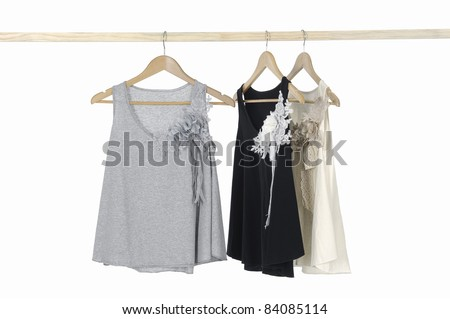 Fashion clothing hanging on wooden hangers