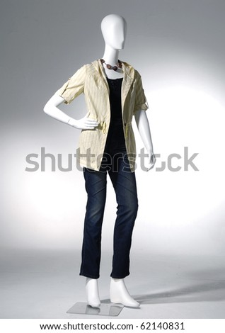 Fashion clothing on mannequin on light - stock photo