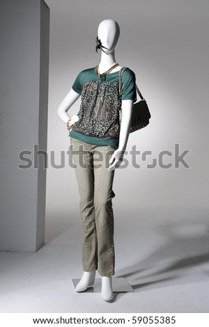 Fashion clothing on mannequin on light background