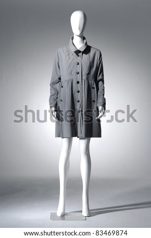 Fashion coat clothes on a mannequin in light background