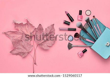 Fashion cosmetic makeup autumn Set. Collection beauty product on pink art background. Trendy accessories Brushes Eyeshadow, handbag. Creative Flat lay, make up fall cosmetic fashionable concept