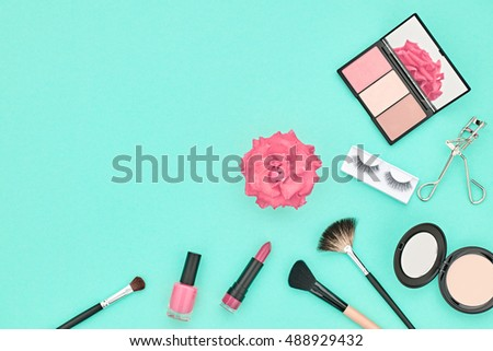 Fashion Cosmetic Makeup. Woman Beauty Accessories Set. Essentials. Makeup background. Fashion Design. Lipstick Brushes Eyeshadow, fashion Eyelashes, Rose. Minimal Concept. Top view. Cosmetic Overhead