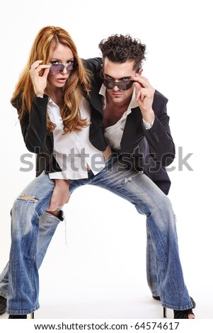fashion couple look to the camera