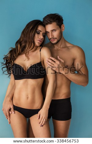 Fashion couple touching each other. Emotional portrait of unusual couple #338456753