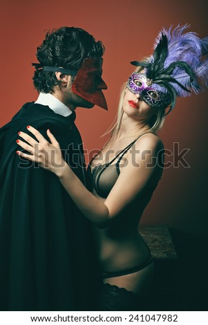01a48423d7030 Fashion couple wearing venetian masks. Venice masquerade and carnival  #241047982 · Fashion woman in lingerie wearing venetian mask and mysterious  man.