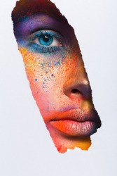Fashion creative art of makeup. Abstract colourful splash make-up. Holi festival