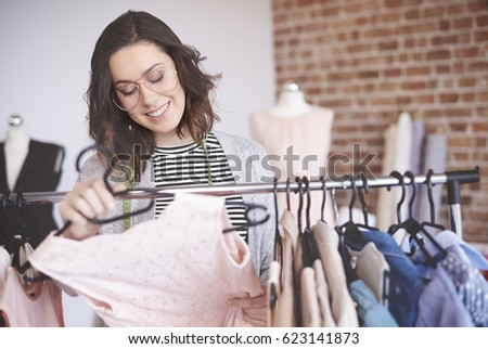 Shutterstock Fashion designer searching outfits on clothing racks