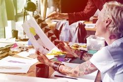 Fashion Designer Sketch Discussing Costume