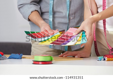 Fashion designer with many color samples in their hands #114931351
