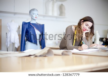 Fashion designer working on her designs in the studio