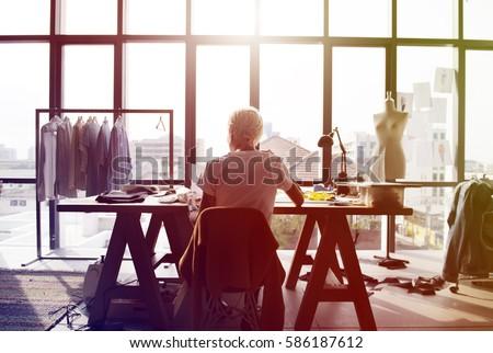 fashion designer working on her ...
