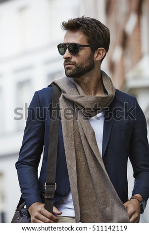 Fashion dude in scarf and shades, looking away