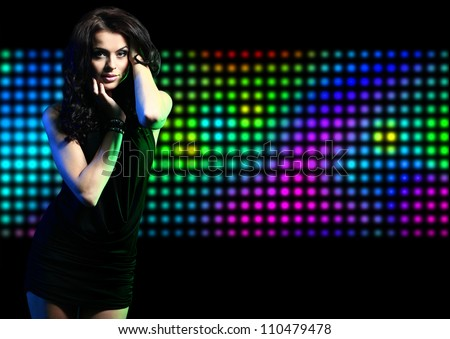 Fashion expressive girl dancing at disco light
