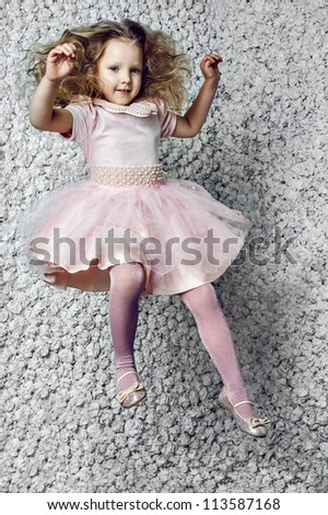 Fashion face wonderful child flies in a dream on paper white background
