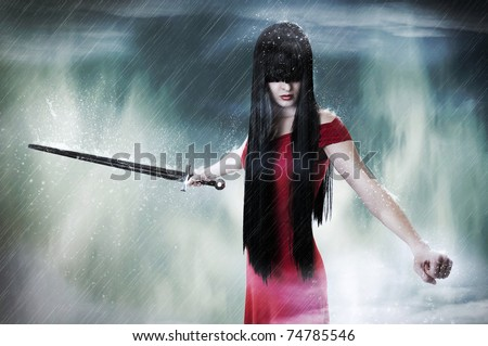 Stock Photo Fashion fantasy portrait of young pretty brunette woman fighter with sword in mist