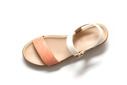 Fashion female and woman leather sandals or wedges sandals with solid white background
